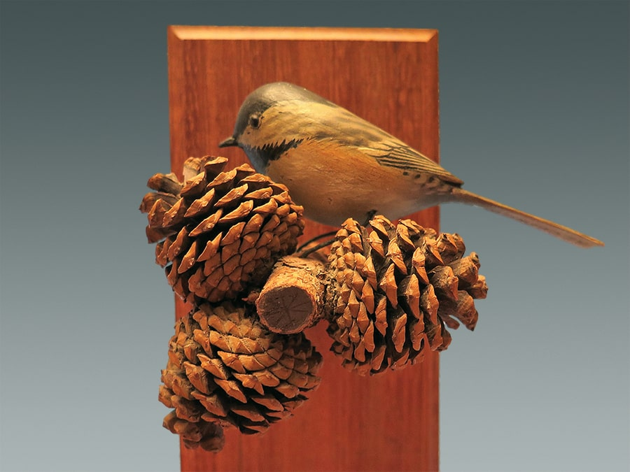 chick with pine cones-min